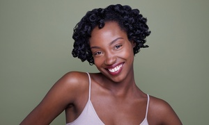All Texture Unisex Hair and Nails Spa Inc.: Dread Twists, Straw Curls, or Natural Hair Twists at All Textures Unisex Hair & Nail Spa (Up to 56% Off)