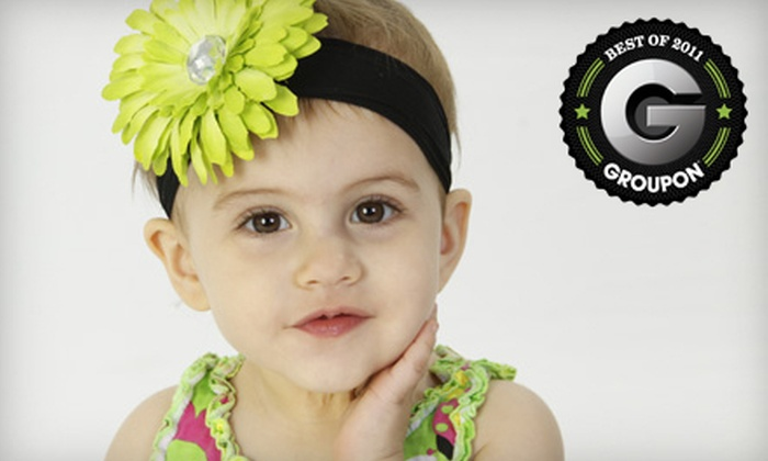 CL!X Portrait Studios - Derby: In-Studio Portrait Package or Baby's First Year Portrait Package at CL!X Portrait Studios (Up to 80% Off)