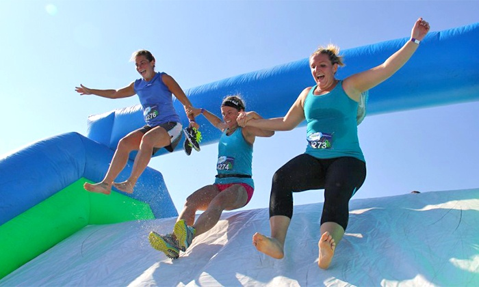 Insane Inflatable 5K - Apalachee Regional Park: $54 for One Registration to Insane Inflatable 5K on Saturday, December 12, at 8:45 a.m.