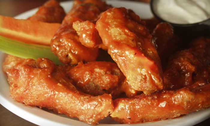 Bikinis Bar & Grill - DeVeaux: $7 for $15 Worth of Burgers, Wings, and Sandwiches at Bikinis Bar & Grill