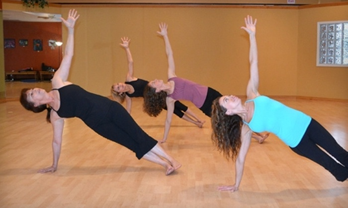 Yoga in Motion - Castle Hills: $42 for a 10-Class Card at Yoga in Motion ($120 Value)