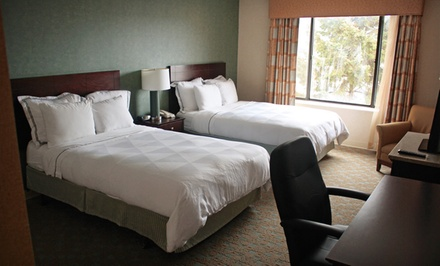 One-Night Stay for Two Adults in a King or Two-Double Room. Up to Three Kids Stay Free in Two Double Room. - Radisson Milwaukee North Shore in Glendale