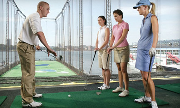 Golf Club at Chelsea Piers - Chelsea: Golf 101 School or Simulator Session with Driving-Range Ball Card at The Golf Club at Chelsea Piers (Up to 56% Off)
