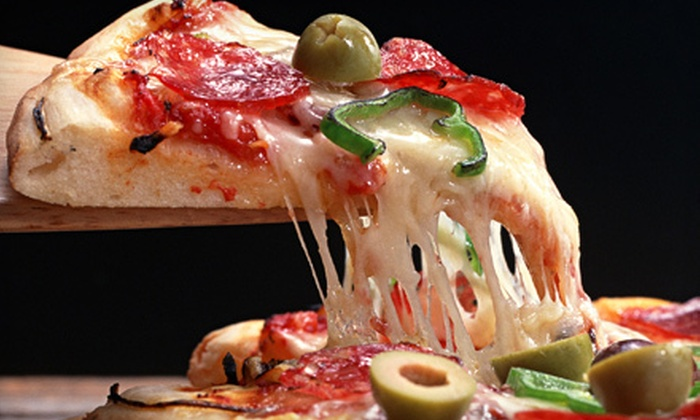 Gumby's Pizza - Gainesville: Pizza or Subs Meal with Beer or Soda for Two or Four at Gumby's Pizza (Up to 55% Off)
