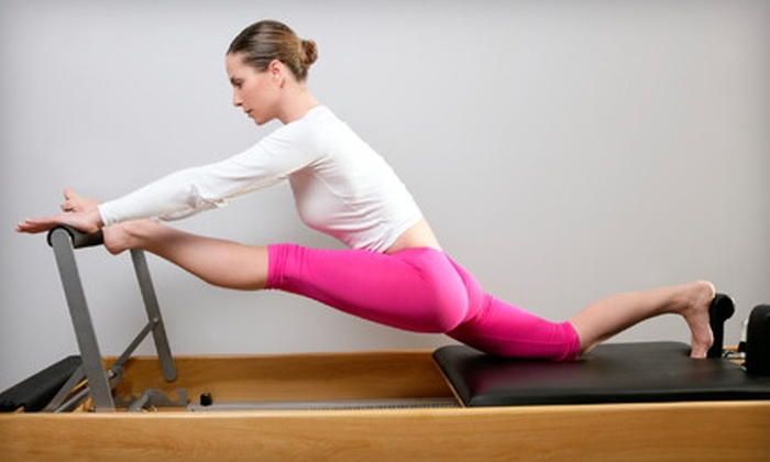 Vitality Pilates Studio - Multiple Locations: $59 for a Four-Week Intro to Pilates Course at Vitality Pilates Studio ($153.71 Value). Three Locations Available.