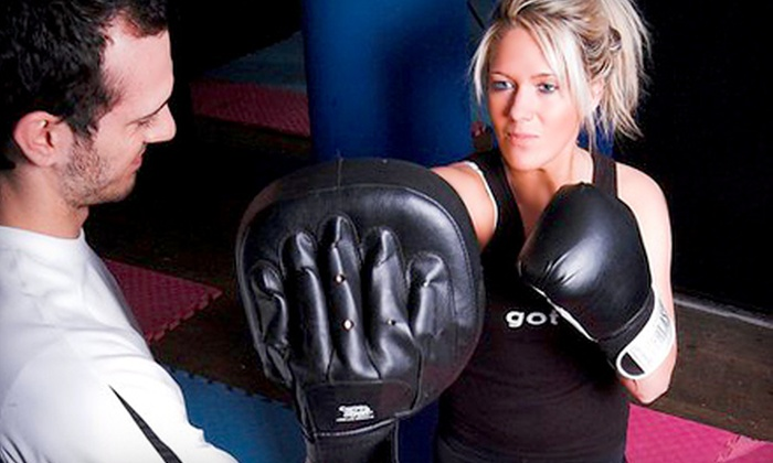 Absolute Boxing & Personal Training for Women - Multiple Locations: $69 for One Year of Kickboxing Classes at Absolute Boxing & Personal Training for Women ($1,550 Value). Two Locations Available.