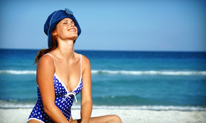 Pacific Coast Tans - Multiple Locations: One Airbrush Tan or One Month of Unlimited Silver-Level Tanning at Pacific Coast Tans