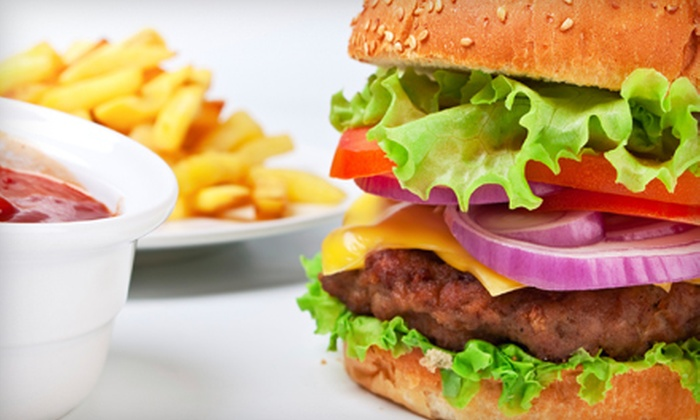 Johnny Rockets - Upper East Side: $9 for Two Burgers or Sandwiches, Two Unlimited Fries, and Two Soft Drinks at Johnny Rockets (Up to $26.88 Value). $15 for Four (Up to $53.76 Value).