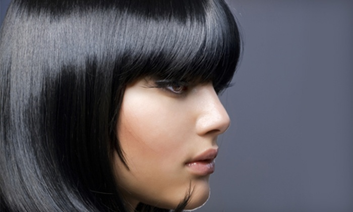 Another Wild Hair - Summerlin: $25 for Shampoo, Tea Tree Sugar Scrub, Paul Mitchell Deep Conditioning Treatment, and Haircut with Style at Another Wild Hair ($130 Value)