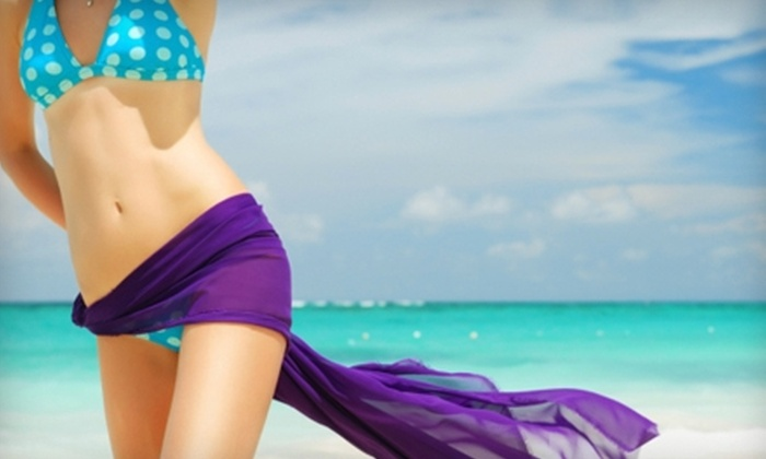 Nurturing U Spa - Detroit: $55 for One SlenderTone Body Wrap and One Aqua-Chi Foot Detox or Two Spray-Tan Applications at Nurturing U Spa in Burton