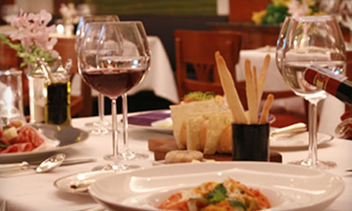 Monetti's Taste of Italy - Lee's Summit: Italian Dinner with Wine for Two or Four at Monetti's Taste of Italy (Up to 59% Off)