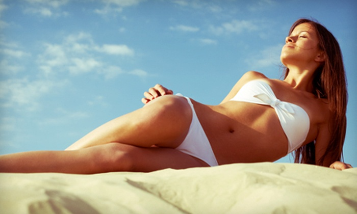 The Tanning Club - Westwood: $39 for 4 Mystic Tans or 10 Level-2 Tanning-Bed or -Booth Sessions at The Tanning Club ($99 Value)