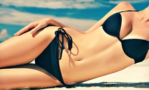 Totally Tan: Two, Five, or Eight Spray Tans or Sessions in a High-Level UV Bed at Totally Tan (Up to 68% Off)