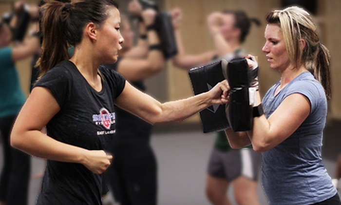 Seung-Ni Fit Club - Multiple Locations: Eight-Week Body Challenge Including Unlimited Fitness Classes, BMI and Body-Fat Testing, Nutritional Coaching, Performance Prizes, and More at Seung-ni Fit Club in Saginaw