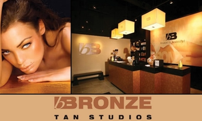 Bronze Tan Studios - Multiple Locations: $25 for 30 Days of Prepaid Unlimited Tanning Plus Two Spray Tans at Bronze Tan Studios