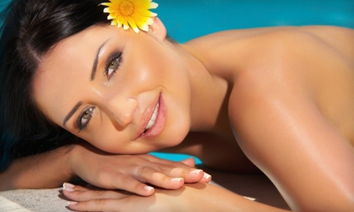 Darque Tan - Multiple Locations: Spray Tan and Red-Light Therapy or Tanning-Bed Session and Red-Light Therapy at Darque Tan