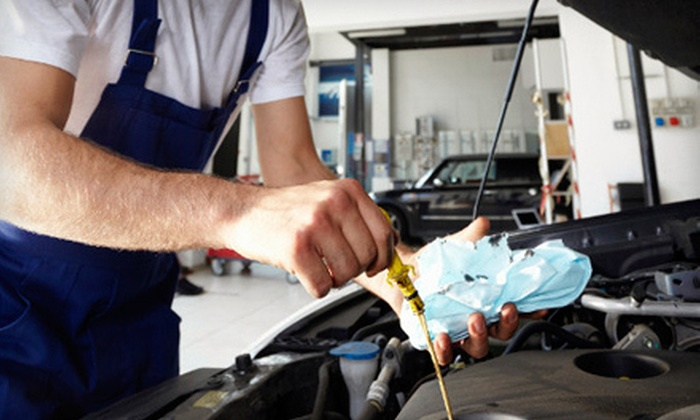 Clark's Car Care - West On Ridge Industrial Park: One or Two Full-Service Oil Changes or Air-Conditioning Service at Clark's Car Care in Naperville (Up to 62% Off)