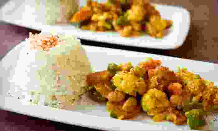 African Palace Bar & Grill - Florissant: $16 for African Fare for Two with Wine at African Palace Bar & Grill in Florissant (Up to $37.98 Value)