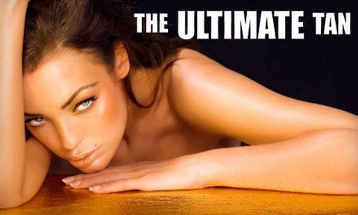 Ultimate Tan - East Ridge: $10 for One Month of Unlimited Tanning or One Spray Tan at Ultimate Tan (Up to $40 Value)