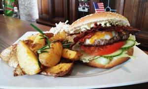 Restaurant Rodeo: Hamm-Burger Rodeo mit Kartoffeln, Coleslaw und American Brownie für Zwei od. Vier im Restaurant Rodeo ab 14,90 €