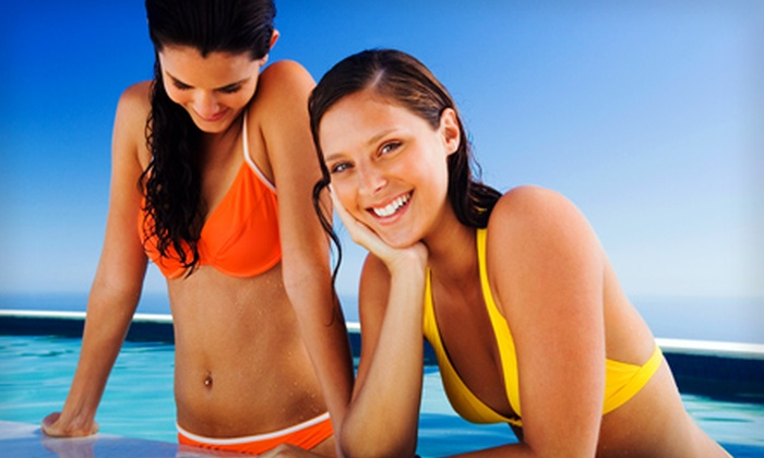 Darque Tan - Multiple Locations: 30 Days of UV Bed Tanning or Sunless Tanning at Darque Tan