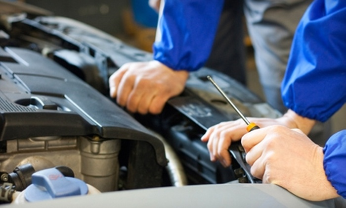 Express Tire & Auto Service - Multiple Locations: $34 for Oil Change Service Package at Express Tire & Auto Service ($154.45 Value)