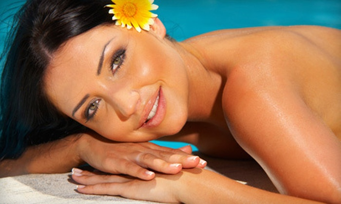 Body Heat Tanning - Coral Springs: One or Three Airbrush Spray Tans or One Month of Unlimited Tanning at Body Heat Tanning in Coral Springs (Up to 75% Off)