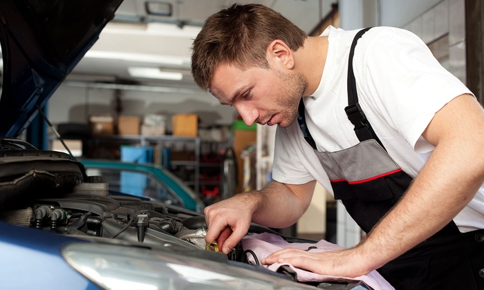 Community Car Care - Lincolnia: Conventional or Synthetic Oil Change with 27-Point Inspection and Tire Rotation (Up to 68% Off)