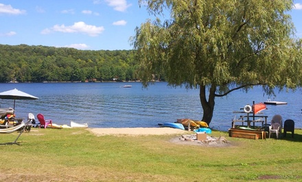groupon daily deal - 2-Night Stay in a Cottage for Up to Six at Ogopogo Resort in Ontario's Haliburton Highlands. Combine Up to 4 Nights.