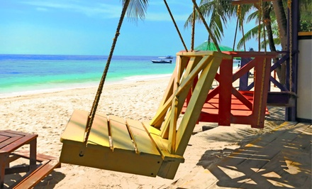 groupon daily deal - 4- or 7-Night Stay for Two in a Beachside Villa or Luxury Condo at Island Pearl Resort on Roatán, Honduras