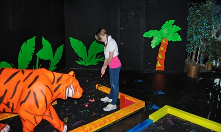 18-Hole Round of Blacklight Mini Golf for Two or Four at Safari Mini Golf (50% Off)