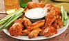 Frankies Bar and Grill - Multiple Locations: Pub Food and Drinks or a Game-Day Package with Wings, Nachos, and a Beer Tower at Frankie's (Up to Half Off)