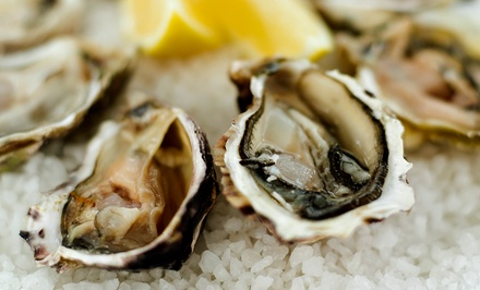 Two or Four Dozen Oysters at the DOCKS seafood + steak + oyster bar (Up to 54% Off)