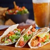 Up to 50% Off Lunch or Dinner for Two at Uptown Bar & Grill