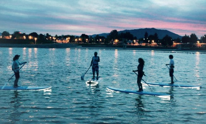 Paddleboard Fitness with Lisa G - Marina Village: Summer Paddleboarding Party for 6 or Sunset Paddleboarding Tour for 2 at Paddleboard Fitness with Lisa G (Up to 52% Off)