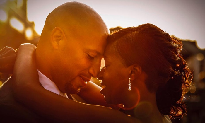Schelle' Photography - Baltimore: Engagement or Wedding Photo Package, or Both from Schelle' Photography (Up to 75% Off)