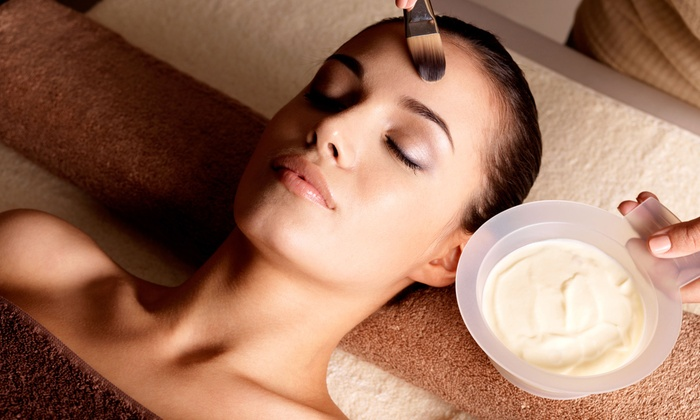 Claudia Skin Care Center - Claudia Skin Care: $75 for Revitalight Photofacial or Microdermabrasion Facial at Claudia Skin Care Center (Up to $150 Value)