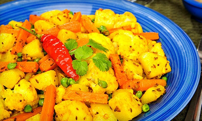 Gandhi Restaurant - Astoria: $20 for an Indian Dinner for Two with Appetizer, Entrees, and Sides at Gandhi Restaurant (Up to $43 Value)