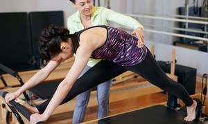 "Passport Pilates Studios: Five Pilates Reformer Classes or ""Smart Start"" Intro to Pilates at Passport Pilates Studios (Up to 50% Off)"
