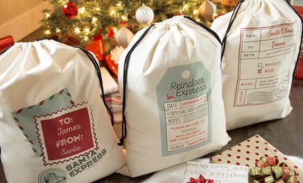 1, 2, 3, 5, or 10 Personalized Jumbo Santa Gift Bags from Qualtry (Up to 87%)