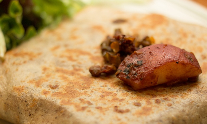Creperie Saint Germain - Evanston: Three-Course Dinner with Wine for Two or Four or $10 for $20 Worth of French Cuisine at Creperie Saint Germain