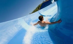 Liquid Planet Water Park: Water-Park Visit with Zipline Ride and Mini Golf for 1, 2, or 4 at Liquid Planet Water Park (Up to 53% Off)
