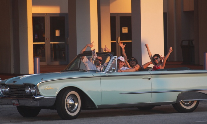 City Tour in an Antique Car - City Center: 30- or 45-Minute Antique/Classic Convertible Ride for Four from City Tour in an Antique Car (Up to 50% Off)