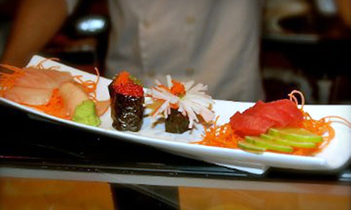 Sushi on the Rocks - Wholesale District: $35 for Sushi Dinner for Two with Appetizers, Rolls, and Martinis at Sushi on the Rocks (Up to $71.98 Value)