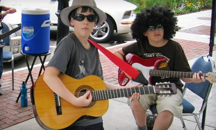 My Music Skool - Multiple Locations: $50 for Four Group Vocal, Violin, or Guitar Lessons at My Music Skool ($100 Value)
