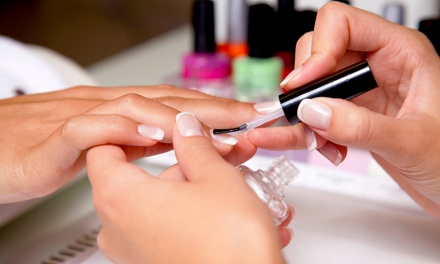 No-Chip Manicure with Complimentary Eyebrow Threading or Spa Mani-Pedi at Vinni's Salon & Spa (Up to 38% Off)
