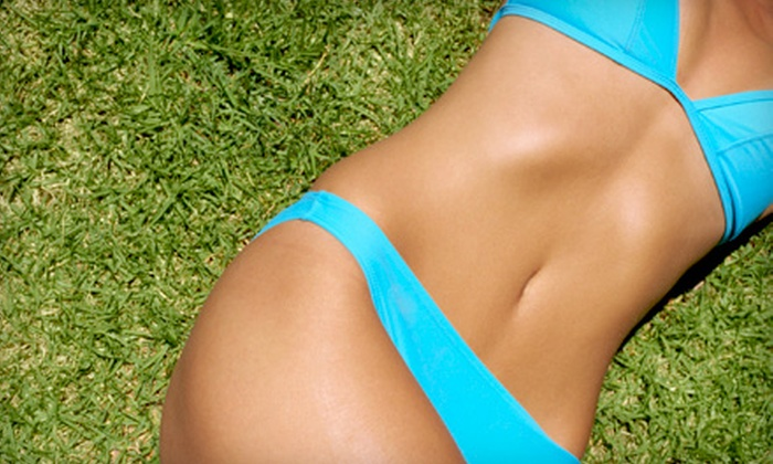 Hollywood Tans - Ballantyne East: One, Three, or Six Months of Tanning or 20 Mystic Spray Tans at Hollywood Tans (Up to 60% Off)
