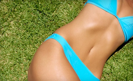 1 Month of Unlimited HT60 Tanning or Three Mystic Spray Tans (Up to a $100 value) - Hollywood Tans in Charlotte
