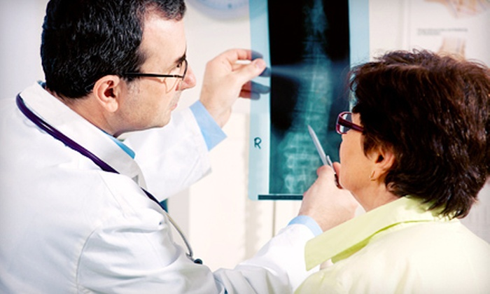 Live Well Chiropractic LLC - Midtown: $49 for a Chiropractic Package with X-rays, Exam, Adjustment, and Massage at Live Well Chiropractic LLC ($943 Value)