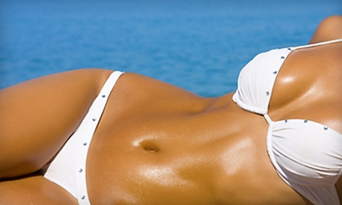 Golden Tan - Multiple Locations: $20 for Two Spray Tans or Ten Silver-Level Bed Tans at Golden Tan